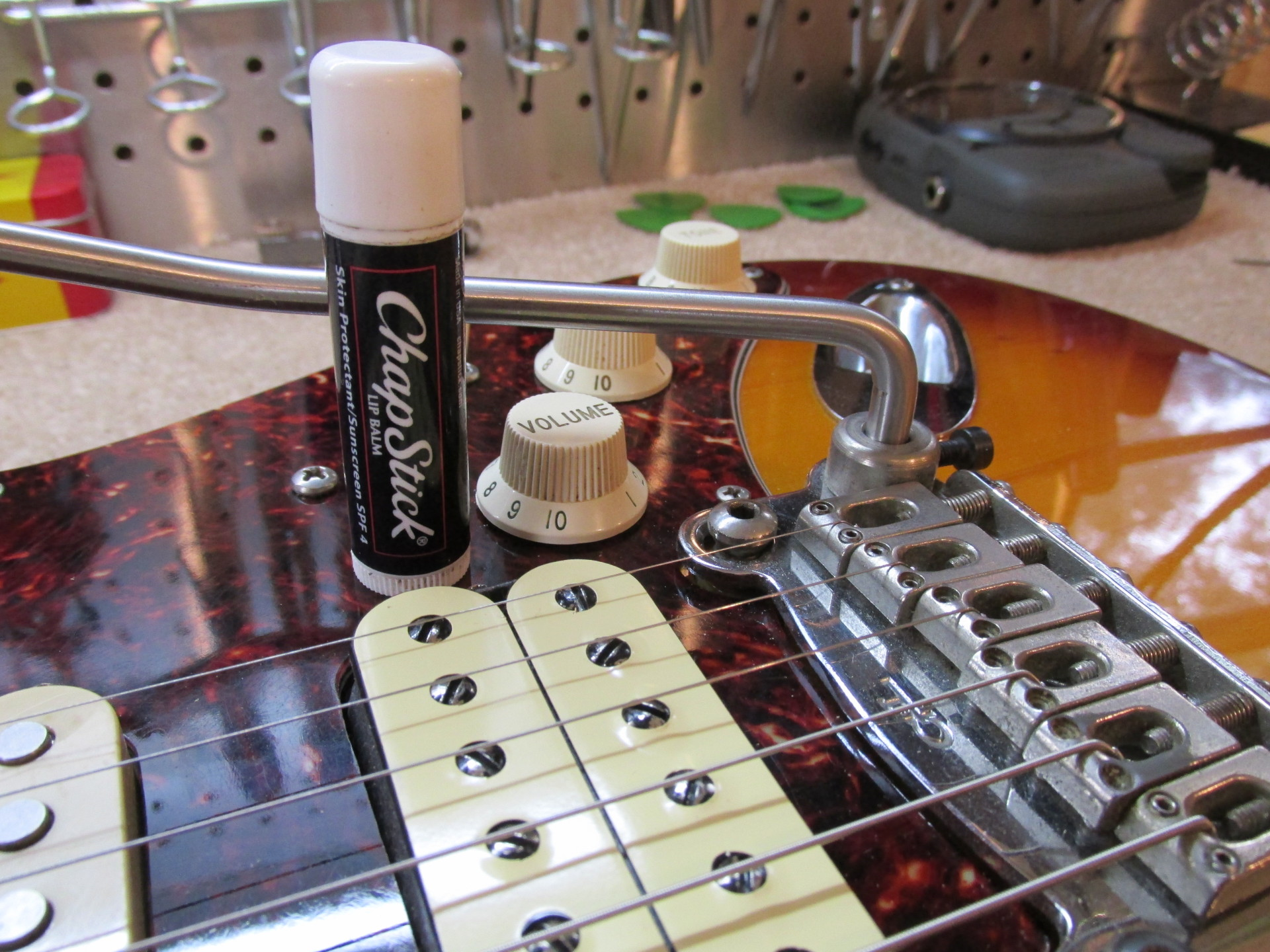Fact, not friction: Lip balm as a guitar tool